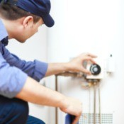 Repairman working on water heater