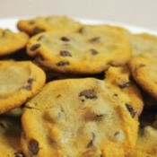 Flat chocolate chip cookies on a plate