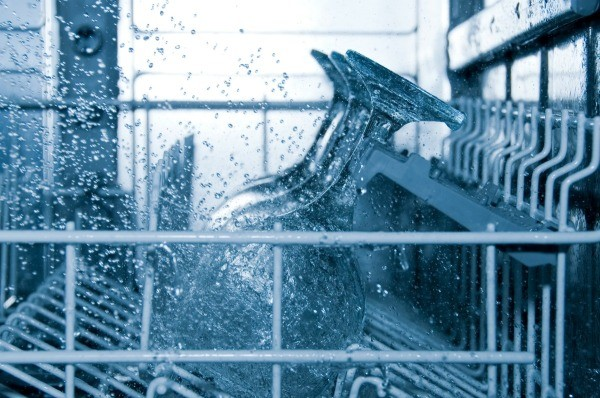 Inside view of dishwasher during wash cycle