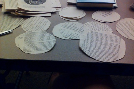 Book pages cut in circles for making rosettes.