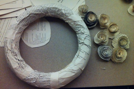 Wreath form covered in paper, ready for rosettes.