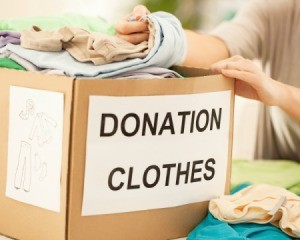Woman with a box labeled Donation Clothes