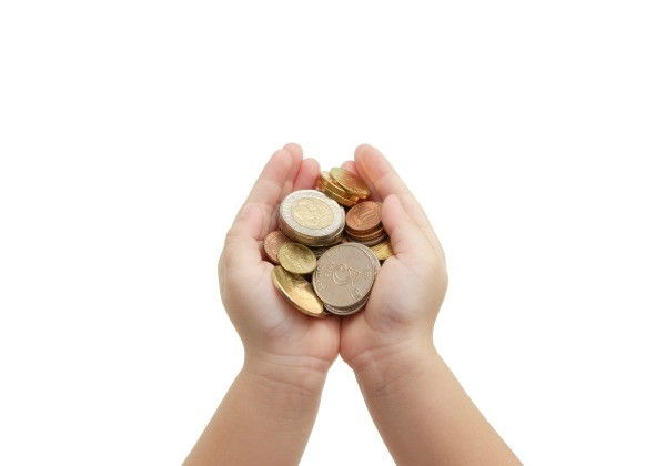 Childs cupped hands holding coins