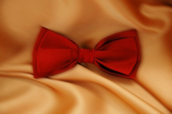 Red bowtie on a satin background