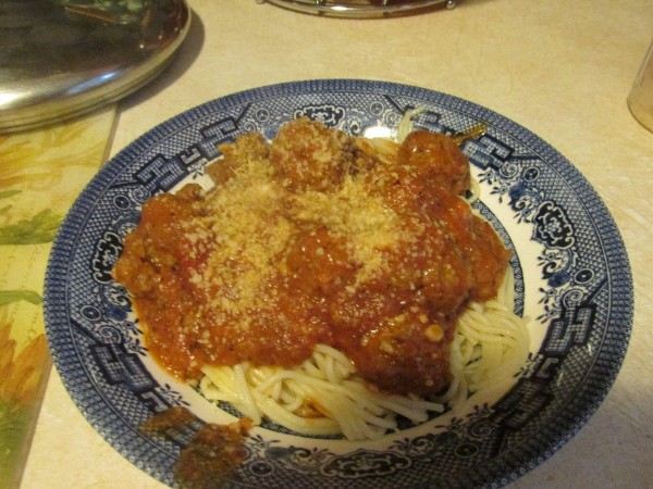Quick Fresh Meatballs - Meatballs serviced with sauce over spaghetti noodles.
