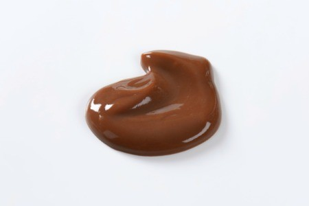 Blob of hocolate pudding isolated on a white background