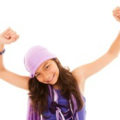 Tween girl dancing against a white background