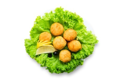 Veggie balls on a large lettuce leaf