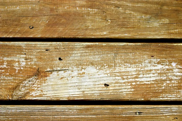 Close up of wood deck with holes