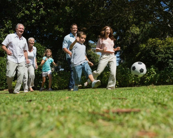 Multi-generational family playing soccer