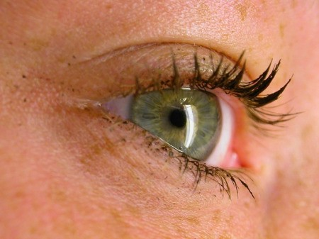 Close up of a woman's eye with thick mascara on the lashes