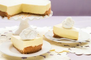 Lemon Chiffon Pie slices on plates with pie in the background