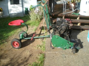 old mower with a tractor type ride behind seat