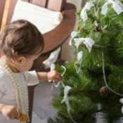 Toddler helping hand decorations on Christmas Tree