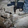 Man removing concrete with a jackhammer
