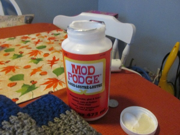 A bottle of Mod Podge for sealing knots and frays on a crochet project.