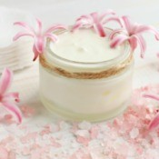 Jar of face cream with pink flowers
