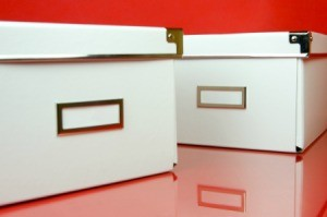 White Storage Containers on a red background.