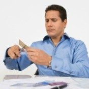 Man cutting up credit cards