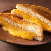 A grilled cheese sandwich made with American block cheese.