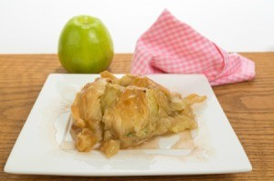 Baked apple dumplings on a plate.