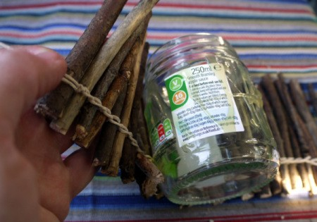 wrapping twigs around the jar