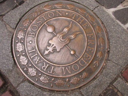 A bronze seal on the walkway in Boston.
