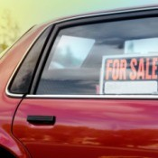 Close up of car rear window with For Sale Sign
