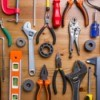Variety of tools displayed on wooden background