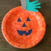 A Jack-o'-Lantern made from a paper plate.