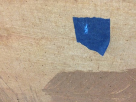blue painter's tape on back of canvas
