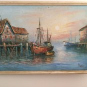 repaired painting hanging on wall