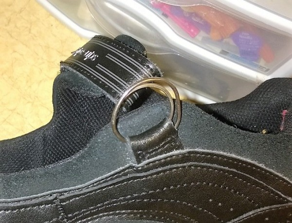 A shoe that has been fixed with a key ring.
