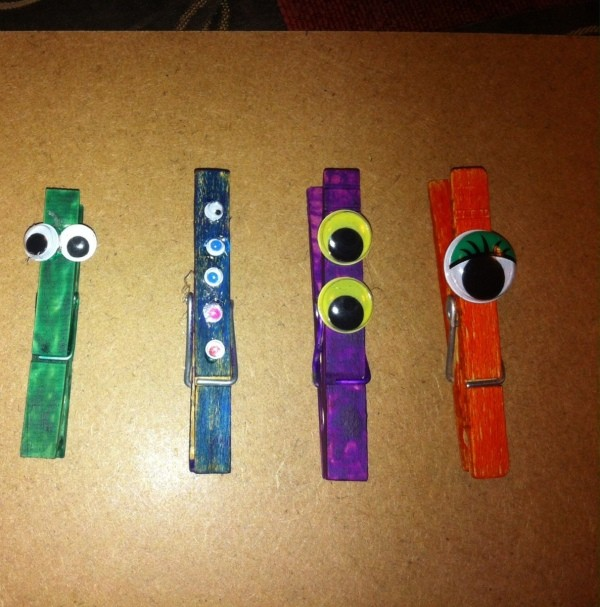 four different monster clothes pins