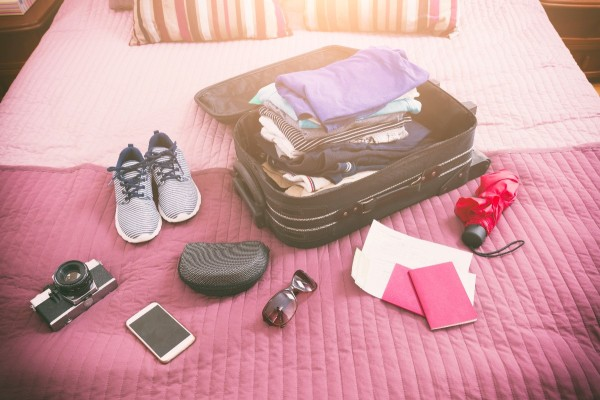 A well packed suitcase with travel basics.