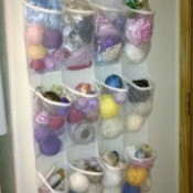 craft supplies stored in back of door shoe storage bag