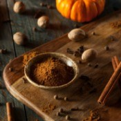Ground pumpkin pie spice with whole spices.