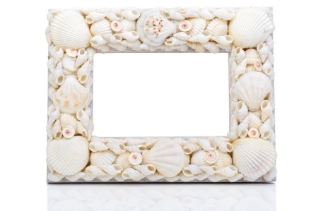 A picture frame made from seashells.