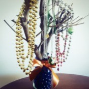 branch and jar jewelry tree with necklaces