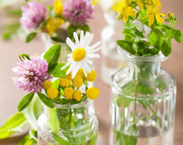 Jars used as flower vases for a church banquet.