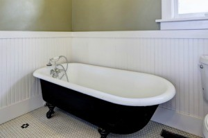 A claw foot tub in a bathroom.