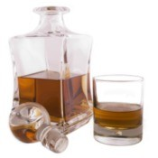 A whiskey decanter with a stopper.