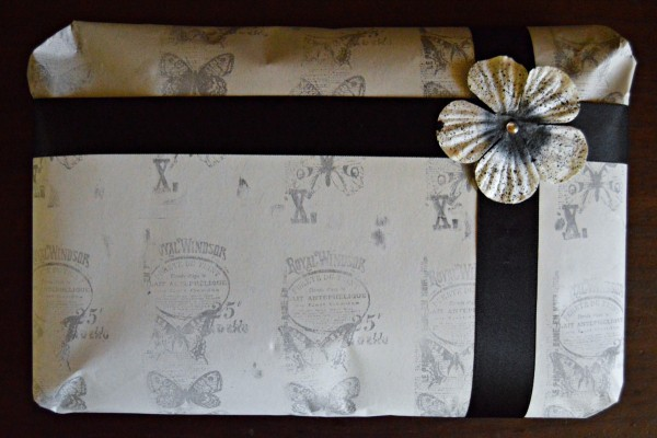 A hand stamped gift wrapped package.