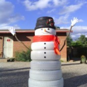 large tire snowman in desert yard