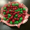 A bowl made of melted peppermint starlight candies, filled with M&Ms
