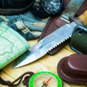 A knife, map, compass and other items helpful when hunting or fishing.