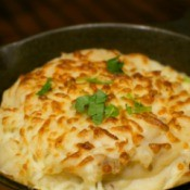 A dish of cheesy mashed potatoes.