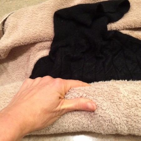 How to Wash a Cashmere Sweater - roll the sweater up in the towel