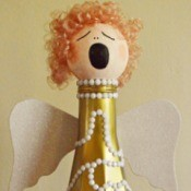 singing angel made from a glass bottle