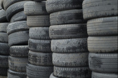 Tall stacks of used car tires.